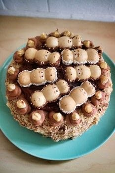 Sponge cake with Nutella icing, hazelnuts and Happy Hippos! .  Free tutorial with pictures on how to bake a sponge cake in under 60 minutes by cooking, baking, and decorating food with butter, caster sugar, and vanilla. Recipe posted by Cat Morley.  in the Recipes section Difficulty: Simple. Cost: 3/5. Steps: 15