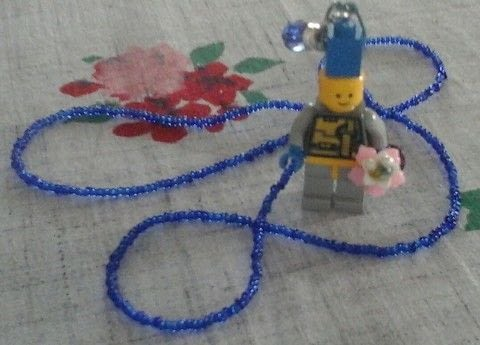 Small lego robot with  bouquet on a beaded necklace .  Make a beaded necklace in under 150 minutes by beading and jewelrymaking with glass seed beads, beadcaps, and flower beads. Inspired by lego and swarovski. Creation posted by Brenda J M.  in the Jewelry section Difficulty: Simple. Cost: Cheap.