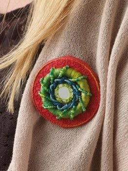 Raised Embroidery .  Free tutorial with pictures on how to stitch a stitched brooch in under 120 minutes by jewelrymaking and embroidering with silk, silk ribbon, and seed beads. How To posted by Search Press.  in the Jewelry section Difficulty: 3/5. Cost: Cheap. Steps: 35