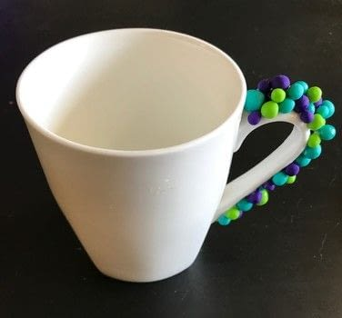 Drink coffee out of a color-popping DIY mug .  Free tutorial with pictures on how to make a cup / mug in 3 steps using mug, mod podge dishwasher safe gloss, and paintbrush. How To posted by Lindsey Mae.  in the Home + DIY section Difficulty: Simple. Cost: 3/5.