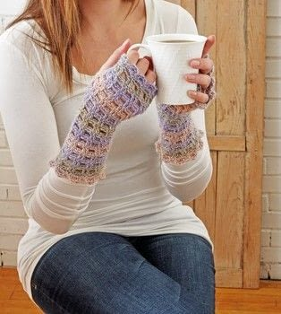 Designer Crochet .  Free tutorial with pictures on how to make fingerless gloves in 3 steps by crocheting with yarn and crochet hook. How To posted by Creative Publishing international.  in the Yarncraft section Difficulty: 3/5. Cost: 3/5.