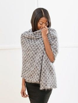 Designer Crochet .  Free tutorial with pictures on how to make a shawl in 2 steps by crocheting with yarn, yarn, and crochet hook. How To posted by Creative Publishing international.  in the Yarncraft section Difficulty: 4/5. Cost: 4/5.