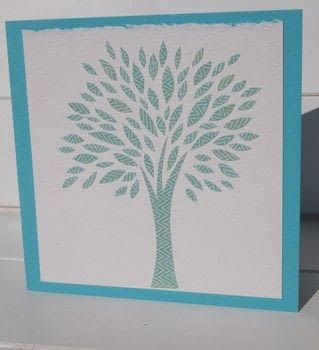 Paper cut tree card .  Free tutorial with pictures on how to make a greetings card in under 30 minutes by papercrafting and cardmaking with card, glue, and white. Inspired by trees. How To posted by Elizabeth  Moad.  in the Papercraft section Difficulty: Simple. Cost: Absolutley free. Steps: 3