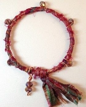 Let soft sari silk wrap your wrist in boho chic comfort .  Free tutorial with pictures on how to make a wrapped bangle in under 30 minutes using crystal beads, silk ribbon, and gauge. How To posted by Tammie E. [TTE Designs].  in the Jewelry section Difficulty: Simple. Cost: Cheap. Steps: 4