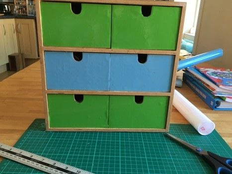 Craft box revamp .  Free tutorial with pictures on how to make a drawer in under 60 minutes by decorating and transfering with scissors, ruler, and craft knife. Inspired by for boys. How To posted by Heather C.  in the Home + DIY section Difficulty: Easy. Cost: Cheap. Steps: 3