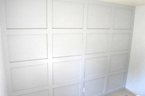 Looking to make an accent wall? This DIY board & batten grid wall makes a serious statement in any room. .  Free tutorial with pictures on how to make wall decor in 7 steps using paint, wood, and knife. Inspired by rooms in the house and house. How To posted by Marly D.  in the Home + DIY section Difficulty: 4/5. Cost: 3/5.