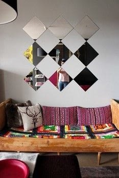 Learn how to re-use old eighties mirrors in a new stylish way.  .  Free tutorial with pictures on how to make a wall mirror in under 120 minutes using mirror tile, mounting tape, and cotton yarn. How To posted by Sannu Vaarala.  in the Home + DIY section Difficulty: Easy. Cost: Cheap. Steps: 6