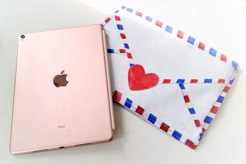 Keep your iPad safe in style with a postage envelope inspired sleeve! .  Free tutorial with pictures on how to make a tablet sleeve in 19 steps by decorating and sewing with felt, pins, and sewing machine. How To posted by Cat Morley.  in the Sewing section Difficulty: 3/5. Cost: 3/5.