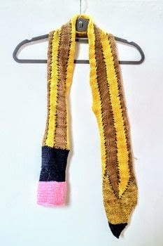 Keep warm with an HB pencil inspired pencil scarf! .  Free tutorial with pictures on how to make a knit scarf / crochet scarf in 4 steps by knitting with yarn, yarn, and knitting needles. How To posted by Cat Morley.  in the Yarncraft section Difficulty: Simple. Cost: Cheap.