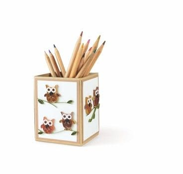 A hoot of a present! .  Free tutorial with pictures on how to make a pot in under 60 minutes by papercrafting and quilling with tools, quilling paper, and pots. Inspired by owls. How To posted by Search Press.  in the Papercraft section Difficulty: Simple. Cost: Cheap. Steps: 5
