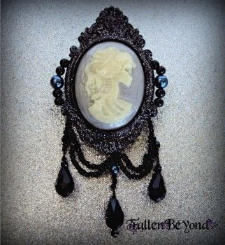 A skeleton lady that glows in the dark, nestled in a glittery black frame. .  Mold a clay brooch using felt, thread, and beads. Inspired by halloween, gothic, and skulls & skeletons. Creation posted by FallenBeyond.  in the Jewelry section Difficulty: 4/5. Cost: 3/5.