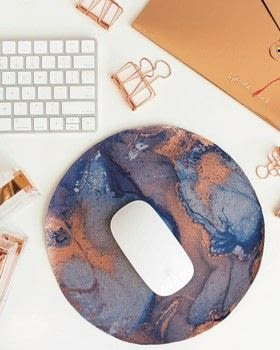 Make Yourself at Home .  Free tutorial with pictures on how to make a mousepad in under 35 minutes by decorating and marbling with faux leather, self healing mat, and bowl. How To posted by GMC Group.  in the Home + DIY section Difficulty: Simple. Cost: Cheap. Steps: 6