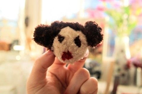 Make a fuzzy Princess Leia pompom! .  Free tutorial with pictures on how to make a pom poms in under 40 minutes by yarncrafting with pompom makers, yarn, and yarn. Inspired by star wars and princess leia. How To posted by Cat Morley.  in the Yarncraft section Difficulty: Simple. Cost: Cheap. Steps: 24