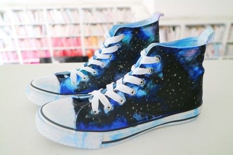 Turn a plain pair of white Converse into a sparkling galaxy with Sharpies! .  Free tutorial with pictures on how to paint a pair of painted shoes in under 120 minutes by decorating and dyeing with converse, sharpies, and rubbing alcohol. Inspired by converse and galaxy print. How To posted by Cat Morley.  in the Decorating section Difficulty: 3/5. Cost: Cheap. Steps: 15
