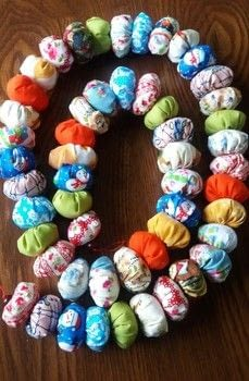Scrap Buster Project .  Make a garland in under 180 minutes by hand sewing with fabric scraps, crochet cotton, and polyester stuffing. Inspired by christmas. Creation posted by PixieFey.  in the Sewing section Difficulty: Easy. Cost: Absolutley free.