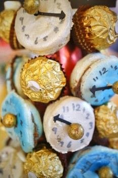 Count down the hours to your celebration with a macaron clock tower! .  Free tutorial with pictures on how to make decorative tablewear in under 120 minutes by baking and decorating with polystyrene, wrapping paper, and macarons. Inspired by new year's eve. How To posted by Cat Morley.  in the Recipes section Difficulty: 3/5. Cost: 4/5. Steps: 11