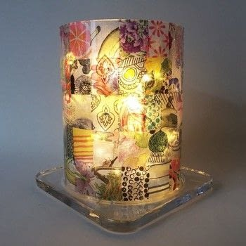 An advanced decoupage project. .  Free tutorial with pictures on how to make a lantern in 6 steps by decoupaging with cloth, lantern, and paper napkins. How To posted by Gabriela Szulman.  in the Home + DIY section Difficulty: 4/5. Cost: 3/5.