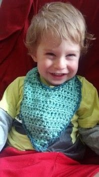 A bib for a drooly toddler .  Free tutorial with pictures on how to make a baby bib in under 120 minutes by crocheting with cutting tool, bulky yarn , and crochet hook. Inspired by gifts and baby showers. How To posted by moonofsilver.  in the Yarncraft section Difficulty: Simple. Cost: No cost. Steps: 5