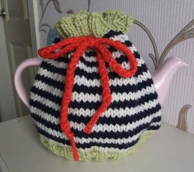 Tea cosy .  Make a home accessory by crocheting and knitting Creation posted by js-m crafts.  in the Yarncraft section Difficulty: Easy. Cost: Cheap.