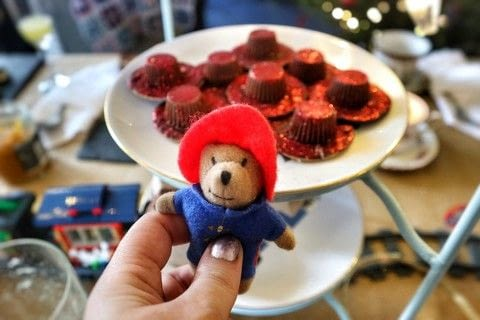 Glittering red Paddington Bear hat inspired cookies! .  Free tutorial with pictures on how to make decorative cookies in under 10 minutes by baking and decorating food with chocolate digestives, peanut butter cups, and nutella. Inspired by paddington bear. Recipe posted by Cat Morley.  in the Recipes section Difficulty: Simple. Cost: Cheap. Steps: 8