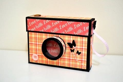 Learn how to make this lovely Camera Box - Step by step Tutorial .  Free tutorial with pictures on how to cut a piece of papercutting in 19 steps by decorating, embellishing, papercrafting, and scrapbooking with glue dots, glue, and score board. Inspired by valentine's day. How To posted by Giulia's Art.  in the Papercraft section Difficulty: 3/5. Cost: Cheap.