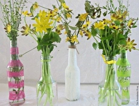 Instead of putting your soy sauce bottles in the recycle bin, use them to add some spring into your home.  .  Free tutorial with pictures on how to make a vase in under 15 minutes using nail polish, masking tape, and bottles. Inspired by flowers. How To posted by Mary-The Boondocks Blog ..  in the Decorating section Difficulty: Easy. Cost: No cost. Steps: 4