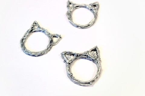 Create a gorgeous cat ear ring with the Scribbler 3D Pen .  Free tutorial with pictures on how to make a plastic ring in under 20 minutes using ring, paper, and pencil. Inspired by cats. How To posted by Cat Morley.  in the Other section Difficulty: Simple. Cost: Cheap. Steps: 11