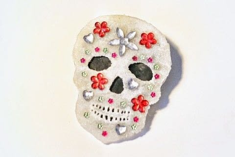 Get sparkly with a glittery shrink plastic sugar skull brooch! .  Free tutorial with pictures on how to make a shrink plastic brooch in under 35 minutes by jewelrymaking with template, shrink plastic, and shrink plastic. Inspired by skulls & skeletons and sugar skulls. How To posted by Cat Morley.  in the Jewelry section Difficulty: Simple. Cost: Cheap. Steps: 11