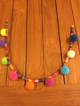 Fun and colourful Pom Pom collar necklace  .  Free tutorial with pictures on how to make a pom pom necklace in under 30 minutes by jewelrymaking and hand sewing with uhu glue, needle, and thread. How To posted by Anne A.  in the Jewelry section Difficulty: Easy. Cost: Cheap. Steps: 9