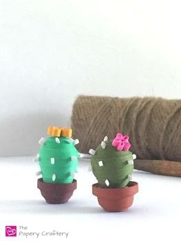 Mini quilled cactus for those with less than a green thumb .  Free tutorial with pictures on how to make a paper model in under 35 minutes by quilling with glue, tacky glue, and mold. Inspired by cactus. How To posted by Meredith A.  in the Papercraft section Difficulty: Simple. Cost: Cheap. Steps: 10