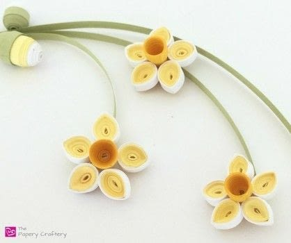 Sweet springtime golden blooms and buds .  Free tutorial with pictures on how to make a paper flower in under 45 minutes by quilling with quilling paper, quilling tool, and glue. How To posted by Meredith A.  in the Papercraft section Difficulty: Simple. Cost: Cheap. Steps: 8
