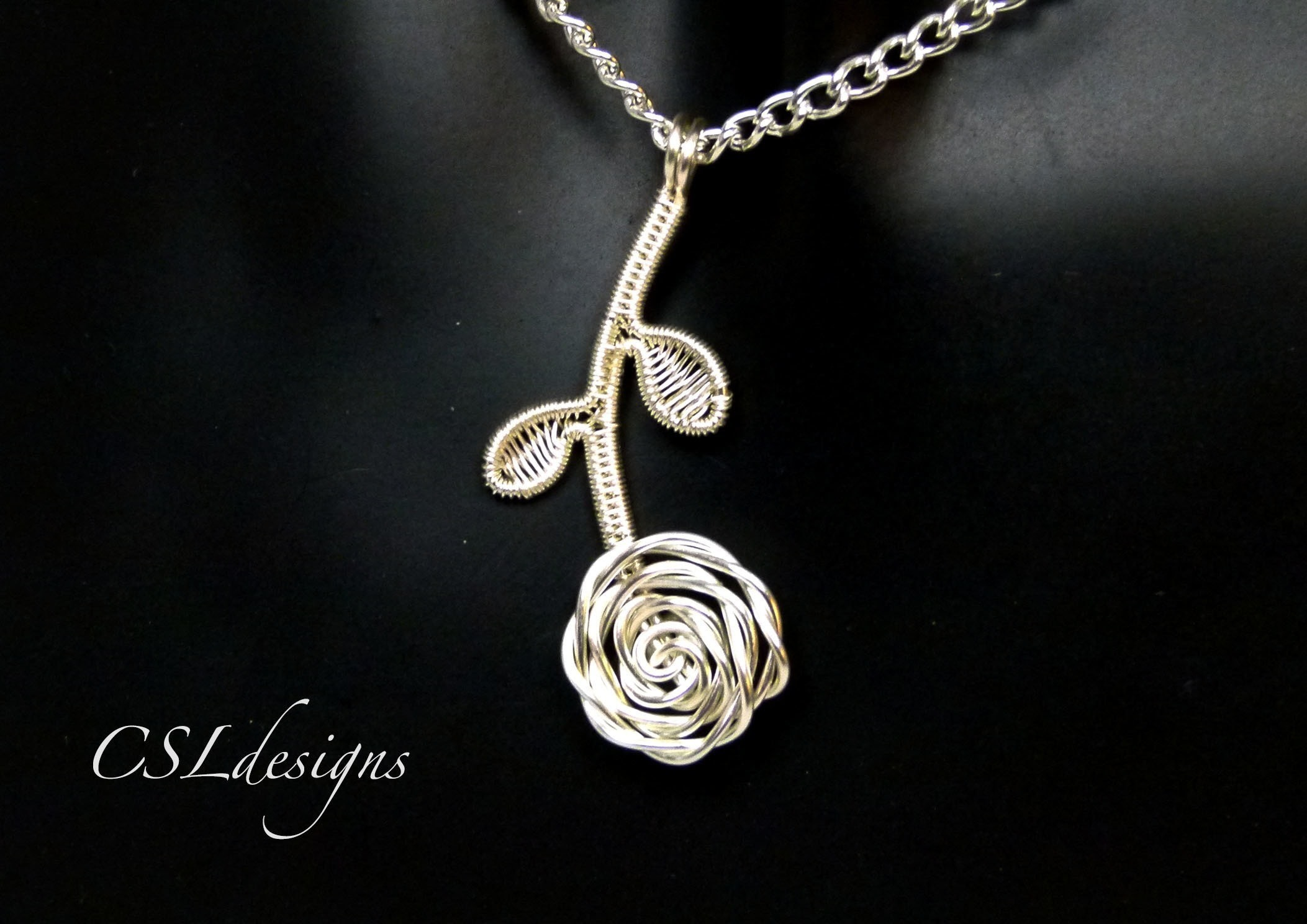 Rose wirework pendant how to make a wire wrapped pendant jewelry make this cute wirework rose pendant free tutorial with pictures on how to make a mozeypictures Choice Image