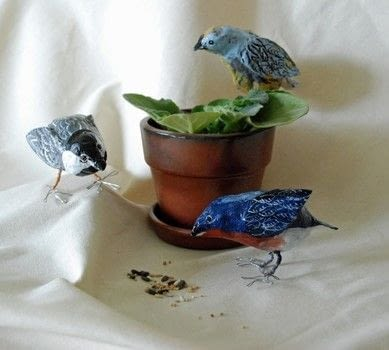 Papier mache, spring, birds .  Free tutorial with pictures on how to make an ornament in under 120 minutes by Papier-mâchéing with wire, acrylic paint, and embroidery thread. Inspired by birds. How To posted by thatartistwoman.  in the Art section Difficulty: Simple. Cost: Absolutley free. Steps: 13