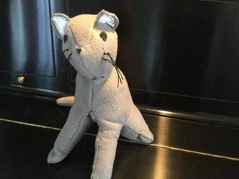 Plush Cat .  Make a cat plushie by hand sewing with needle, fleece, and fleece. Inspired by cats. Creation posted by The Dark Vixen.  in the Sewing section Difficulty: 3/5. Cost: Cheap.