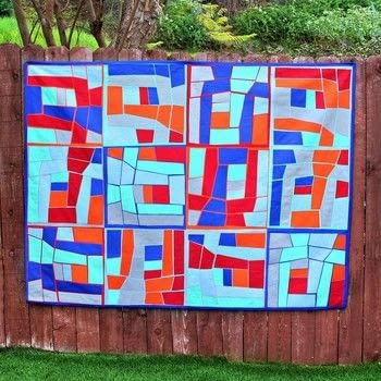 Make a quilt without one single stitch .  Free tutorial with pictures on how to make a patchwork quilt in 4 steps by creating, patchworking, and not sewing with iron, straight pins, and cotton twill. How To posted by Mark Montano.  in the Needlework section Difficulty: 3/5. Cost: 3/5.