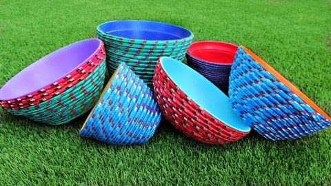 Colorful Rope Bowls without a sewing machine! .  Free tutorial with pictures on how to make a rope basket in under 120 minutes by spraypainting, decorating, embellishing, decoupaging, yarncrafting, and not sewing with glue gun, bowl, and rope. How To posted by Mark Montano.  in the Decorating section Difficulty: Easy. Cost: Cheap. Steps: 3