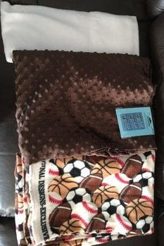 Baby shower gift for parents who are Football fans .  Make a fleece blanket in under 120 minutes by sewing with chenille, fleece, and fleece. Inspired by football. Creation posted by Ozzy's wife.  in the Sewing section Difficulty: 3/5. Cost: 3/5.