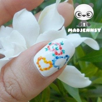 Create beautiful dotted hearts for Spring Season! .  Free tutorial with pictures on how to paint seasonal nail art in under 40 minutes using acrylic paint, 100% pure horsetail base coat, and 100% pure glass top coat. How To posted by Jennifer R.  in the Beauty section Difficulty: Simple. Cost: Cheap. Steps: 2