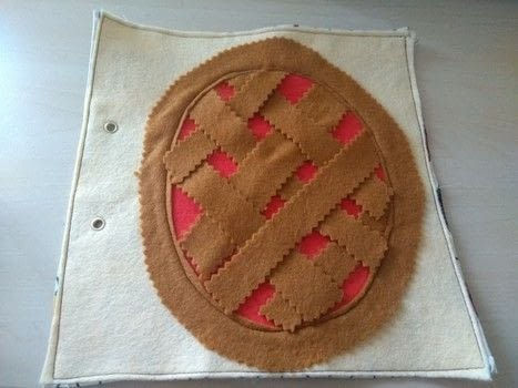 Pie shaped weaving page for quiet book .  Free tutorial with pictures on how to make a play book in under 60 minutes by machine sewing with felt, thread, and material. How To posted by Gemma T.  in the Sewing section Difficulty: Easy. Cost: Absolutley free. Steps: 5