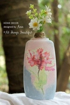 Re-purpose wine bottles to create stunning home decor! .  Free tutorial with pictures on how to make a vase in under 120 minutes by decoupaging with decoupage glue, bottle, and acrylic paint. How To posted by Ann G.  in the Decorating section Difficulty: Easy. Cost: 3/5. Steps: 4
