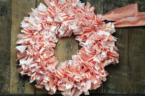 A fun, fast and affordable shabby chic decor project for crafters of all skill levels. .  Free tutorial with pictures on how to make a fabric wreath in under 180 minutes by braiding, decorating, knotting, weaving, and not sewing with fabric, wreath, and scissors. How To posted by Buy This Cook That.  in the Home + DIY section Difficulty: Simple. Cost: Absolutley free. Steps: 7