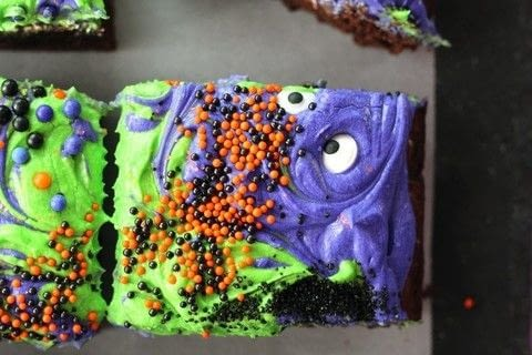 Disclosure: I may have been on a sugar high when I wrote this post. Halloween Season is officially here! The time of monsters and scary movies, haunted houses and spooks. It is also the time for sticky-sweet treats like these Monster Mash Halloween Brownies.  .  Free tutorial with pictures on how to bake a brownie in under 90 minutes by cooking, baking, decorating food, and cake decorating with brownie mix, eggs, and vegetable oil. Inspired by halloween. Recipe posted by Buy This Cook That.  in the Recipes section Difficulty: Simple. Cost: 3/5. Steps: 6