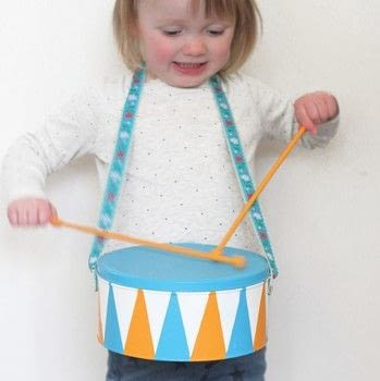 Mini Makers .  Free tutorial with pictures on how to make a drum in under 120 minutes by decorating with tins, balloons, and spray paint. How To posted by GMC Group.  in the Home + DIY section Difficulty: Simple. Cost: Cheap. Steps: 9