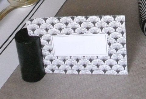 When you invite a crowd you might need name tags .  Free tutorial with pictures on how to make decorative tablewear in under 50 minutes by decorating, papercrafting, collage, and decoupaging with wine corks, nails, and black paint. How To posted by campaspe.  in the Decorating section Difficulty: Easy. Cost: Absolutley free. Steps: 2