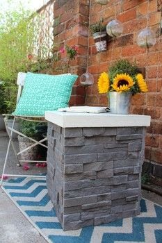 Simple and cheap feature garden table! .  Free tutorial with pictures on how to make an outdoor accessory in under 120 minutes using wood, tiles, and cement board. How To posted by Kezzabeth.  in the Home + DIY section Difficulty: 3/5. Cost: Cheap. Steps: 9