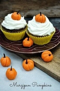 Cute mini Pumpkins made with marzipan .  Free tutorial with pictures on how to make a dessert / sweet in under 10 minutes using marzipan, cloves, and food coloring. Inspired by thanksgiving, cupcakes, and pumpkins. Recipe posted by Bobbie B.  in the Recipes section Difficulty: Easy. Cost: Absolutley free. Steps: 3