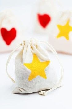 These simple decorated bags are a special way to give a special gift!  .  Free tutorial with pictures on how to make a gift bag in under 60 minutes by stamping with foam, potatoes, and cookie cutters . How To posted by Shelly C.  in the Art section Difficulty: Simple. Cost: Cheap. Steps: 5