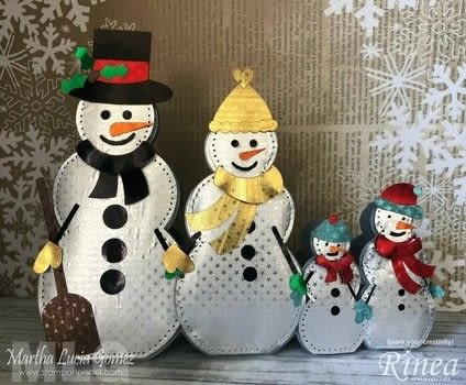 Snowman Family Shaped Card Tutorial .  Free tutorial with pictures on how to make a card in under 120 minutes by cardmaking with cardstock, foiled paper, and cricut. Inspired by christmas and snowmen. How To posted by Malu Gomez.  in the Papercraft section Difficulty: Simple. Cost: No cost. Steps: 3
