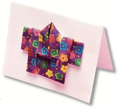 Fabrigami .  Free tutorial with pictures on how to fold an origami card in under 60 minutes by cardmaking and paper folding with fabric, ruler, and glue. Inspired by japanese. How To posted by Tuttle Publishing.  in the Papercraft section Difficulty: Simple. Cost: Cheap. Steps: 11
