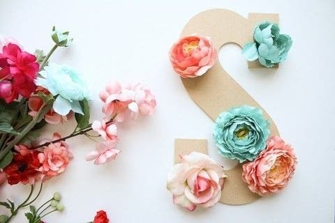 .  Free tutorial with pictures on how to make a letter in under 60 minutes by decorating and embellishing with wooden letter, fabric flower, and hot glue gun. Inspired by floral. How To posted by Shelly| DIY Mama.  in the Home + DIY section Difficulty: Easy. Cost: Cheap. Steps: 5
